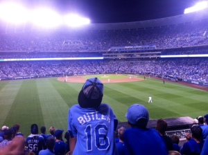 Young brothers watch the first Royals playoff game of their lifetime from the standing-room-only section in left field.