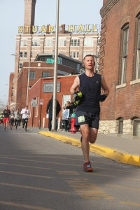 Running through the Crossroads Arts District around Mile 3 of the Great Plains 10K.