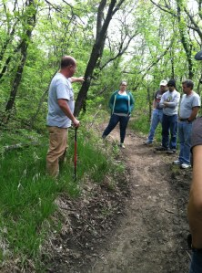Neil Taylor, left, of the Kansas Trails Council provides instruction to members of Saturday's trail maintenance course at Clinton State Park.