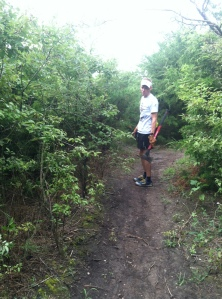 Lawrence Trail Hawks president Bill Loats looks for more overgrowth to lop on the Lake Henry Loop.